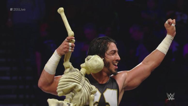 Mustafa Ali celebrates with a skeleton pal after a win on 205 Live