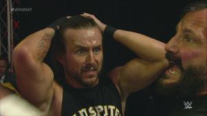 NXT wrestler Adam Cole looks on in shock