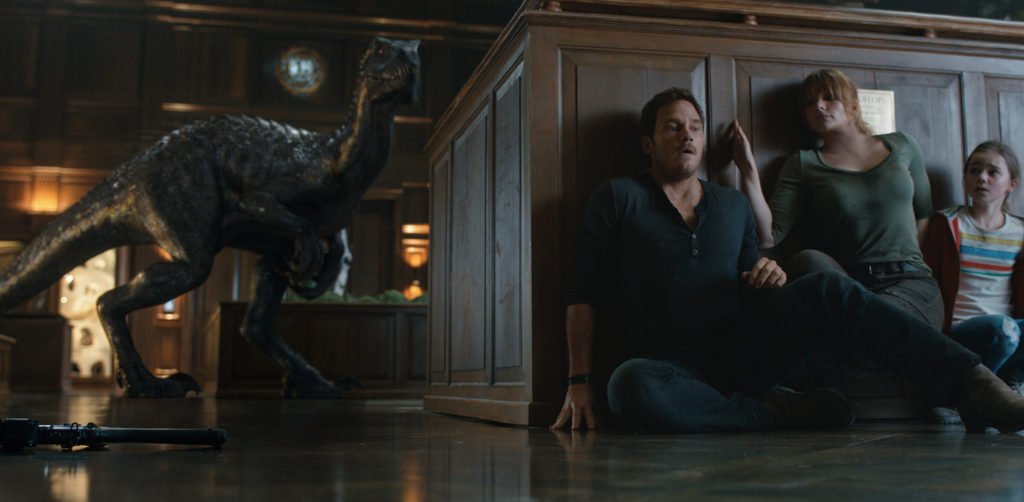 Still of the Indoraptor hunting Chris Pratt, Bryce Dallas Howard, and Isabella Sermon in Jurassic World: Fallen Kingdom, 2018
