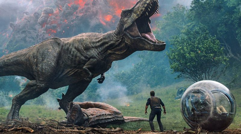 Still of Chris Pratt standing underneath a roaring T. rex in Jurassic World: Fallen Kingdom, 2018